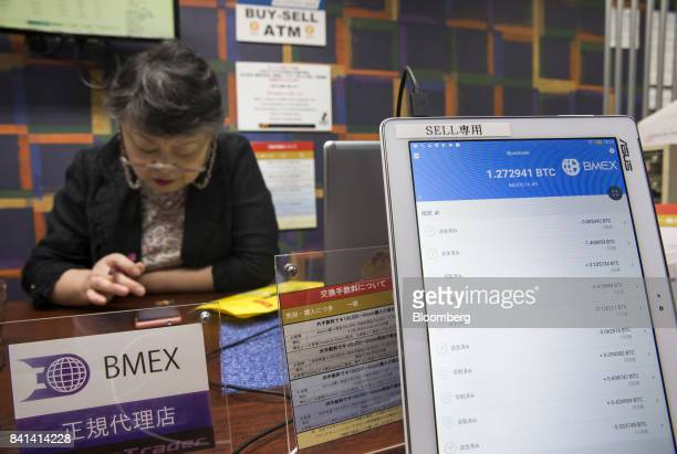 An employee works at the Coin Trader bitcoin retail store in Tokyo Japan on Wednesday Aug 30 2017 Stock of Bitcoin the bestknown digital currency has...