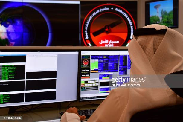 An employee works at the control room of the Mars Mission at the Mohammed Bin Rashid Space Centre , in the Gulf emirate of Dubai. - The oil-rich...