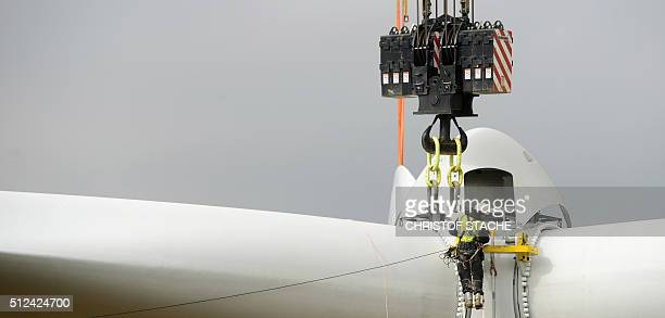 An employee works at the hub of a wind turbine prior the installation of the rotor blades near the small Bavarian village of Sindersdorf near...