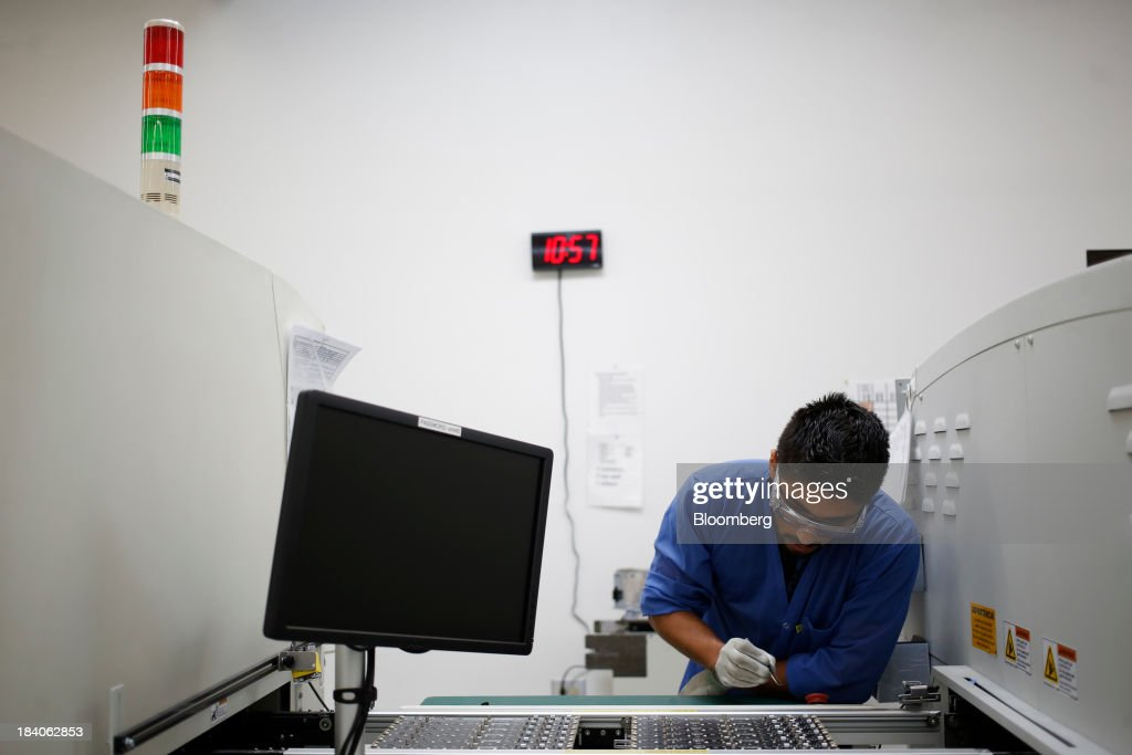 An employee works at the Lithonia Lighting manufacturing facility a subsidiary of Acuity Brands & Acuity Brands LED Light Manufacturing Plant Photos and Images ... azcodes.com