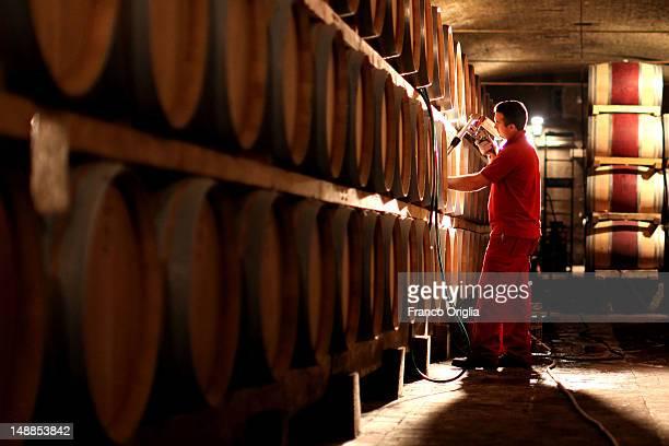 An employee works at The Marchesi de Frescobaldi Nipozzano wine cellar on September 23 2011 in Nipozzano Florence Italy The Castello di Nipozzano...