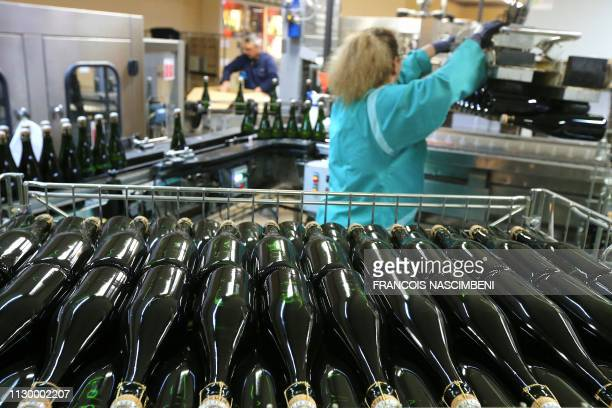 """An employee works at the Pol Roger Champagne factory in Epernay, eastern France on March 7, 2019. - """"Stock and see"""" until the Brexit is the strategy..."""