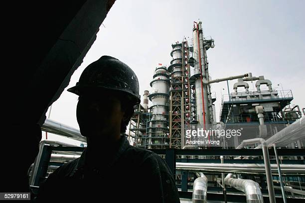 An employee works at the Yanlian Oil Refinery May 25 2005 in Luochuan County Shaanxi Province China About 50 percent of China's oil and natural gas...