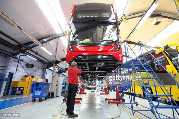 An employee works beneath the drivers cab of an Enviro 400 London bus at the Alexander Dennis Ltd factory in Scarborough UK on Wednesday Sept 13 2017...