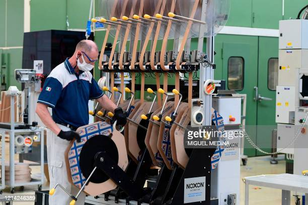 An employee works during his shift the Codogno-based Italian multinational company MTA, specialized in electromechanical components for the...