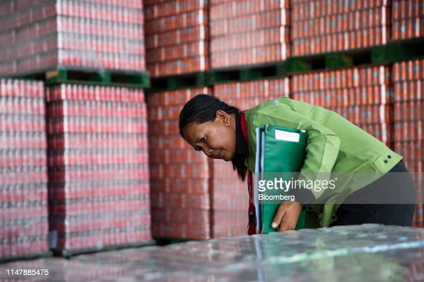 An employee works in a warehouse at the CocaCola Cambodia Bottling Plant operated by Cambodia Beverage Co which is a subsidiary of CocaCola in Phnom...