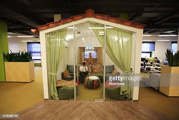 An employee works in an office decorated as a private living room at the headquarters of Yandex NV Russia's largest searchengine company in Moscow...
