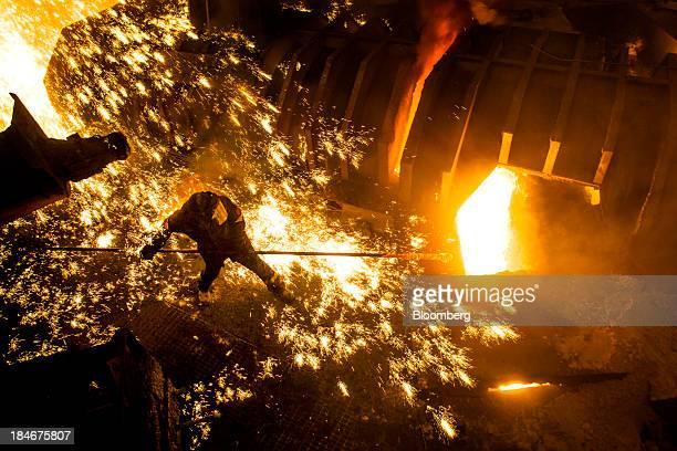 An employee works in front of the blast furnace at the Zaporizhstal steel plant owned and operated by Metinvest BV at their site in Zaporizhzhya...