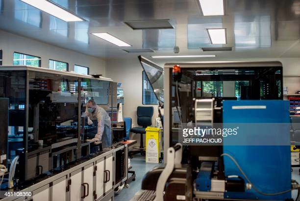 An employee works in the 'analytics biology' section of the 'Person's Identification Department' of the INPS forensic police unit at the National...