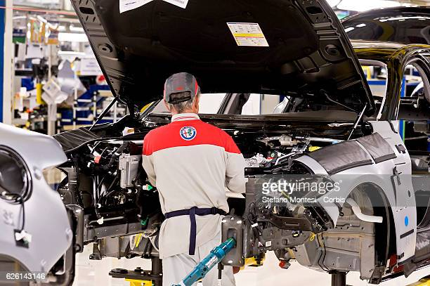 An employee works in the Assembly Lines where they assemble the Alfa Romeo Giulia in the Cassino Assembly Plant FCA Group In this area it takes place...