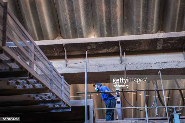 An employee works in the ball mill department at the Shabbir Tiles Ceramics Ltd production facility in Karachi Pakistan on Wednesday Dec 6 2017...