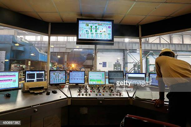 An employee works in the control room of a twin stand mill at the manufacturing facility of Uttam Galva Steels Ltd the Indian unit of ArcelorMittal...