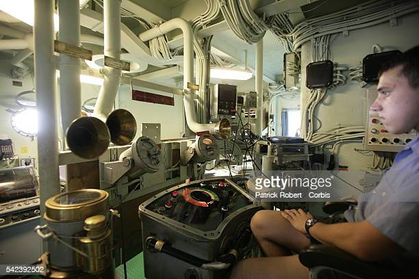 An employee works in the engine room under the bridge on board the Jeanne d'Arc helicopter carrier training ship which was commandeered to lead...