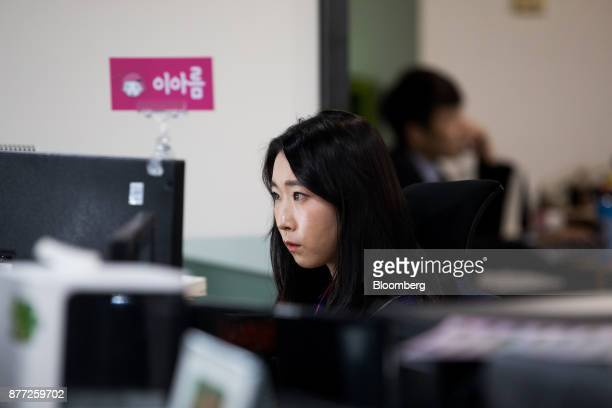An employee works in the office at the Yanolja Co headquarters in Seoul South Korea on Tuesday Oct 10 2017 Yanolja Korean for 'hey let's play' is the...