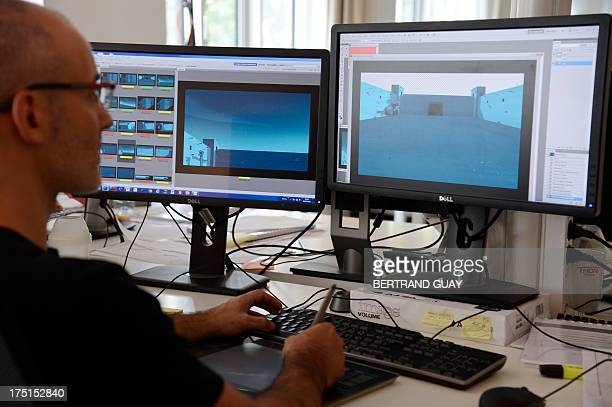 An employee works in the production of an animated film on July 30 2013 at the Xilam French animation production company in Paris Established in 1999...
