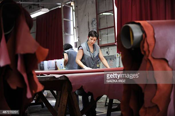 An employee works in the Remy Carriat tannery in Espelette southwestern France on April 10 2014 Since 1927 the tannery carries on the tradition of...