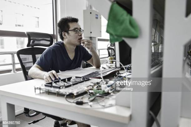 An employee works in the research and development department at Bitmain Technologies Ltd's headquarters in Beijing China on Thursday Aug 10 2017...