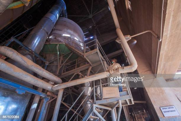 An employee works in the spray dryer department at the Shabbir Tiles Ceramics Ltd production facility in Karachi Pakistan on Wednesday Dec 6 2017...