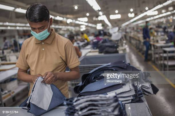 An employee works in the stitching unit at the Artistic Denim Mills Ltd factory in Karachi Pakistan on Tuesday Feb 6 2018 Pakistans manufacturers...