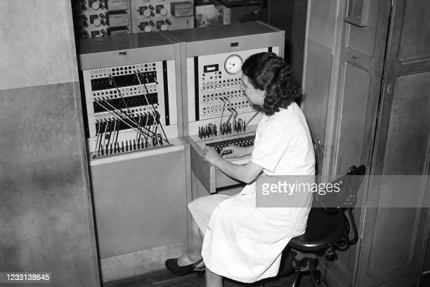 An employee works in the transmissions and switchboard service of the French press agency Agence France Presse in Paris in June 1947.