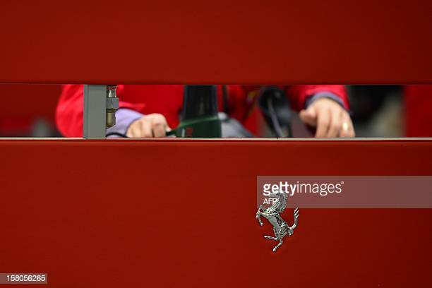 An employee works in the upholstery department of the Ferrari factory on December 5 2012 in Maranello The Ferrari 45 buildings's factory where more...