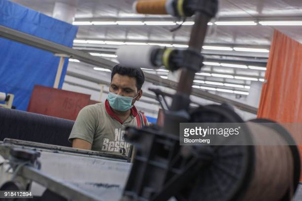 An employee works in the weaving unit at the Artistic Denim Mills Ltd factory in Karachi Pakistan on Tuesday Feb 6 2018 Pakistans manufacturers have...