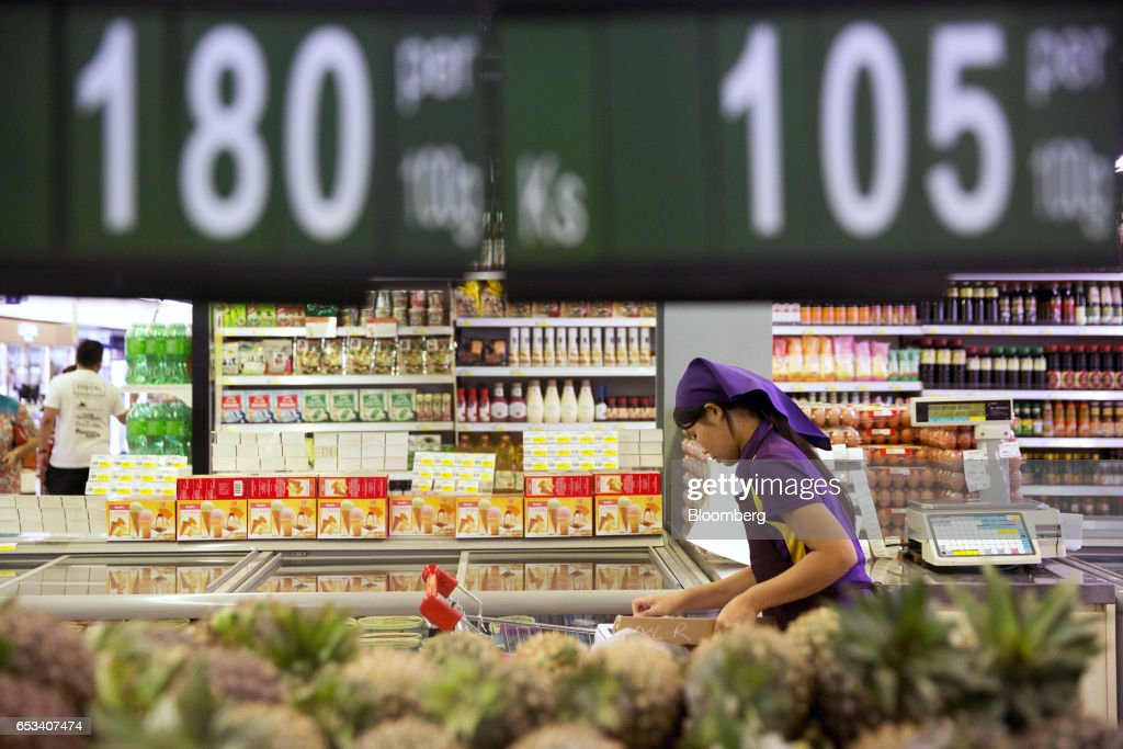 An employee works inside a City Mart Supermarket store, operated by City Mart Holdings Co., in Yangon, Myanmar, on Saturday, March 11, 2017. City Mart has 20 years of market knowledge to help it compete against international players, said Win Win Tint, managing director of City Mart in a Bloomberg interview on March 9. Photographer: Brent Lewin/Bloomberg via Getty Images