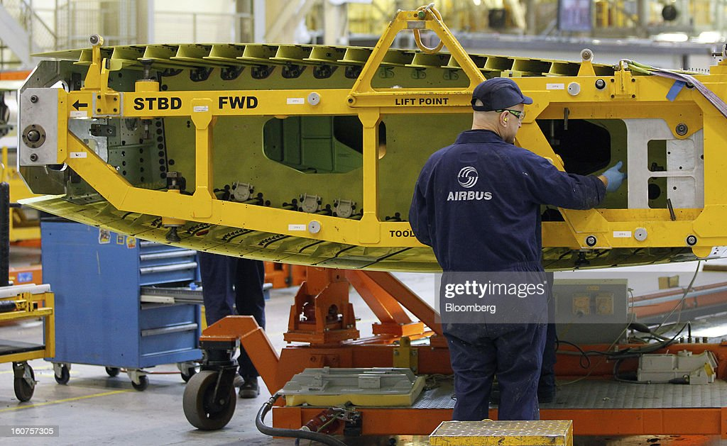An employee works inside a section of Airbus A320 single-aisle passenger aircraft wing during production at the company's factory in Broughton, U.K., on Monday, Feb. 4, 2013. Airbus SAS won a $9 billion order from Steven Udvar-Hazy's Air Lease Corp. that includes 25 A350 wide-body jets, a competitor to Boeing Co.'s grounded 787 Dreamliner. Photographer: Paul Thomas/Bloomberg via Getty Images