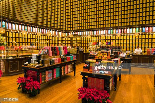 An employee works inside a TWG Tea Co. Store at Terminal 4 of Changi Airport in Singapore, on Thursday, Dec. 13, 2018. Singapore'sChangiAirport,...