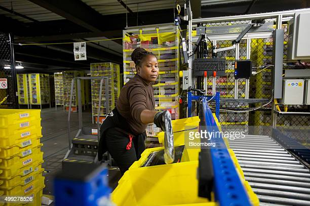 An employee works inside an Amazoncom Inc fulfillment center on Cyber Monday in Robbinsville New Jersey US on Monday Nov 30 2015 Online sales on...
