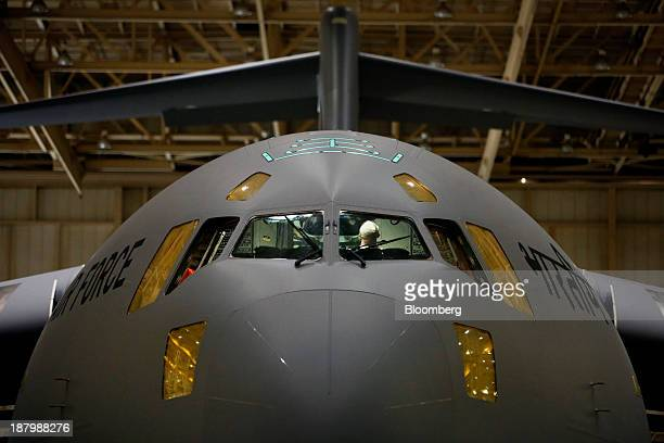 An employee works inside the cockpit of a C17 Globemaster III military cargo jet being manufactured for the Indian Air Force being manufactured at...