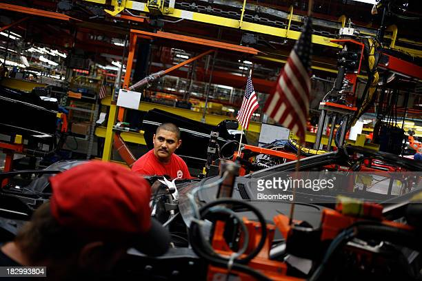 An employee works on a 2014 Chevrolet Corvette Stingray at the General Motors Co. Bowling Green Assembly Plant in Bowling Green, Kentucky, U.S., on...
