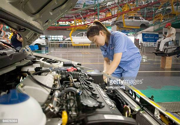 An employee works on a car on the production line at the Chana Motors Co Ltd factory in Chongqing China on Friday June 15 2007 China's factory and...