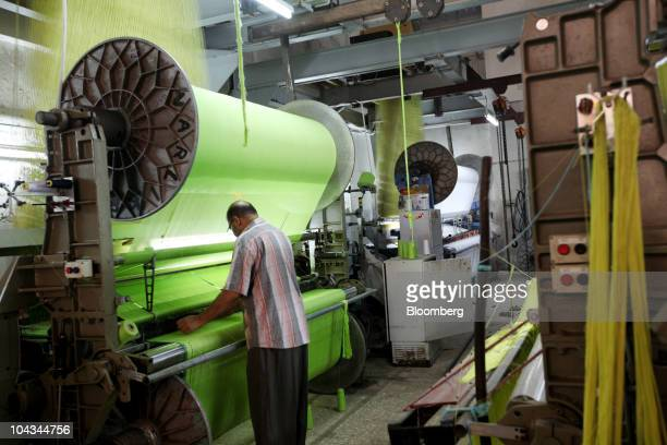 An employee works on a cotton processing machine in a factory in Mahalla Egypt on Tuesday Sept 21 2010 Cotton rose in New York extending a rally to a...
