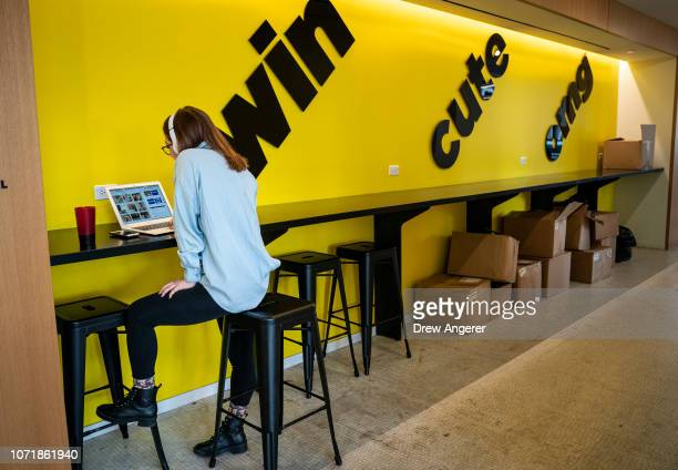 An employee works on a laptop at BuzzFeed headquarters December 11 2018 in New York City BuzzFeed is an American internet media and news company that...