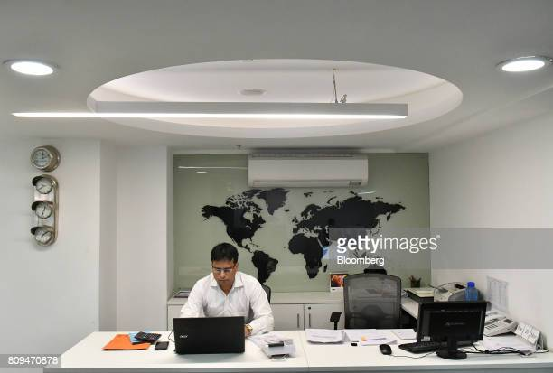 An employee works on a laptop computer at a BLS International Services Ltd office in New Delhi India on Monday March 20 2017 Information technology...