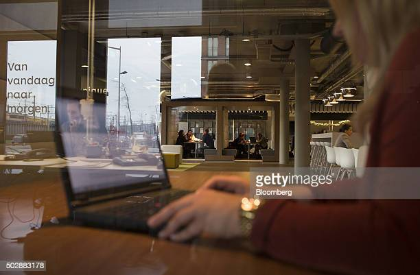 An employee works on a laptop computer inside the Unique job center flagship store operated by USG People NV in Amsterdam Netherlands on Tuesday Dec...