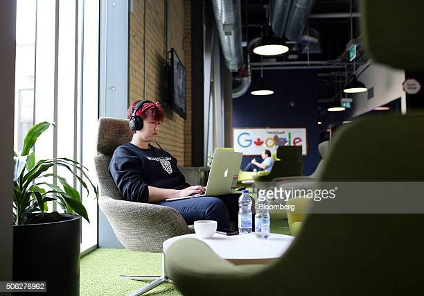 An employee works on a laptop in a common area at Google Canada's engineering headquarters in Waterloo Ontario Canada on Friday Jan 22 2016 The...