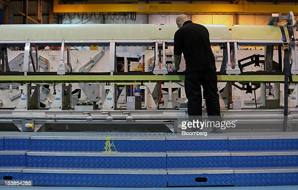 An employee works on a leading wing component for an Airbus SAS aircraft a unit of European Aeronautic Defence Space Co at GKN Plc's Aerospace...