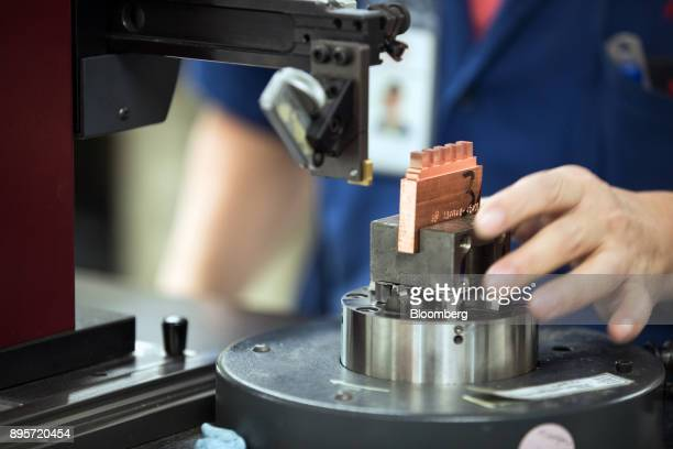 An employee works on a machine inside the molding room at the HiP International Ltd's production facility in Singapore on Thursday Oct 5 2017 HiP is...