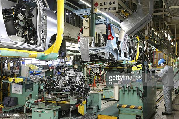 An employee works on a production line at Mitsubishi Motors Corp's Mizushima plant in Kurashiki Okayama Prefecture Japan on Monday July 4 2016...