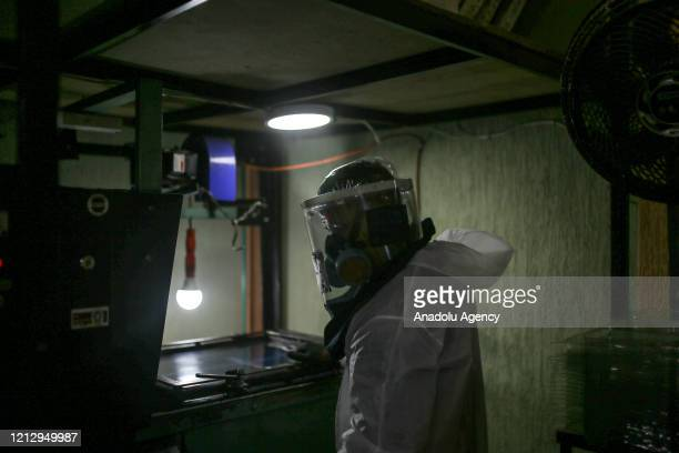 An employee works on a production line of a protective mask called Mascaras de vida in Spanish made by the small factory IMPREMPAQ in the...
