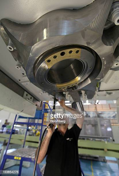 An employee works on a section of wing for an Airbus SAS A380 aircraft a unit of European Aeronautic Defence Space Co at GKN Plc's Aerospace factory...