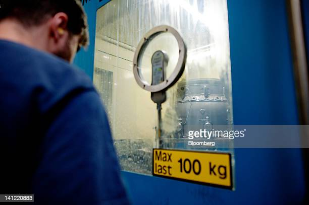An employee works on an aircraft engine at the Volvo Aero factory a division of Volvo AB in Trollhaettan Sweden on Monday March 12 2012 GKN Plc a...