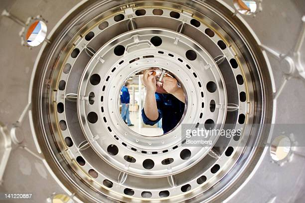 An employee works on an aircraft engine component at the Volvo Aero factory a division of Volvo AB in Trollhaettan Sweden on Monday March 12 2012 GKN...