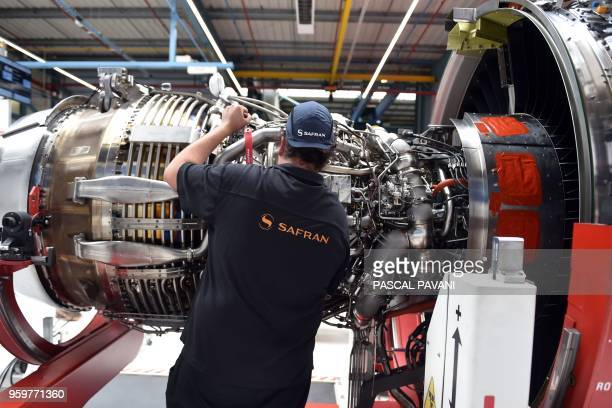 An employee works on an aircraft engine for the Airbus A320 NEO at the industrial and technological engine manufacturer French Safran plant in...