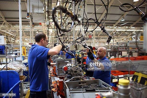 An employee works on an engine production line at a Ford factory on January 13, 2015 in Dagenham, England. Originally opened in 1931, the Ford...