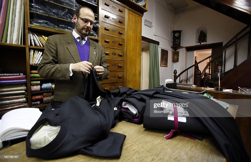 An employee works on clerical garments at the counter inside Gammarelli, an ecclesiastical tailor's store in Rome, Italy, on Friday, Feb. 22, 2013. Gammarelli was founded in 1797 under Pope Pius VI as tailors to the clergy, and lists other papal customers as John Paul I, Paul VI, and John XXIII. Photographer: Alessia Pierdomenico/Bloomberg via Getty Images