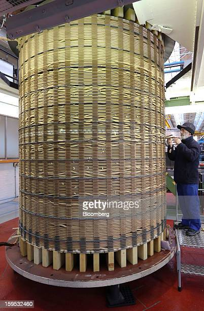 An employee works on copper wires in an electrical coil manufactured for use in industrial power transformers at Alstom SA's factory in Stafford UK...