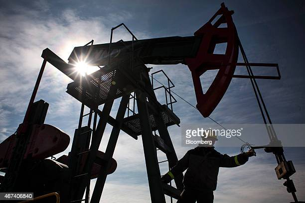 An employee works on oil pumping gear also known as nodding donkeys or pump jacks at an oil plant operated by MND AS in Uhrice Czech Republic on...
